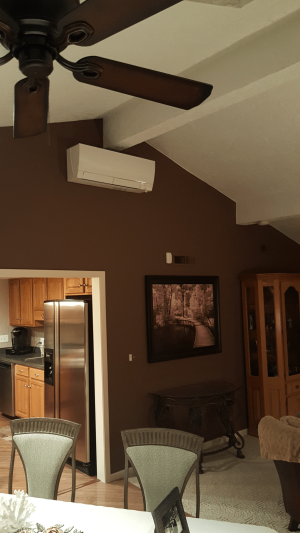 Schaumburg,IL addition, originally heated with a gas ducted furnace with no AC. Compass Heating and Air installaed a MUZX-FH18NA2 and MSZ-FH18NA2 Deluxe indoor ventless ductless Hyper Heat heat pump.