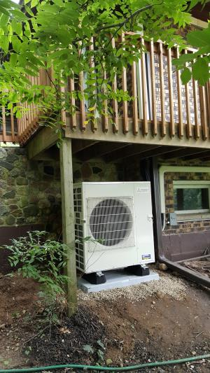 Algonquin, IL 60102 open concept home utilizing a Mitsubishi MXZ-5C42NA heat pump for air conditioning and back up heat. AC installation with boiler radiant heat system.