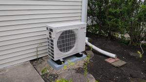 Chicago Bungalow- style home with ahot water boiler used for heat. A MItsubishi 3- zone heat pump provides air conditioning and supplemental heating. Compass Heating and Air- East Dundee