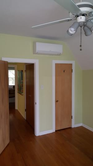 Chicago Bungalow upstairs bedrooms using a Mitsubishi MSZ-GL06NA-U1 wall mounted indoor ductless mini split unit in each bedroom_ part of a 3 zone system installed by Compass Heating and Air.