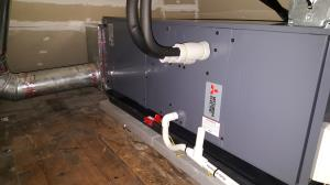 Chicago Mitsubishi MVZ air handler which replaced a natural gas furnace in a knee wall area of a Bungalow.