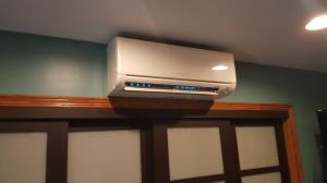 FreshaireUV mini UV system installed in a Mitsubishi Mr. Slim ductless wall- mounted indoor unit to prevent mold  providing clean_ healthy air in this Schaumburg, IL master bedroom.