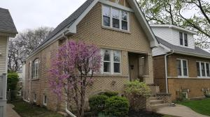 House in Chicago neighborhood utilizing ductless air conditioning and radiant hot water boiler heating.