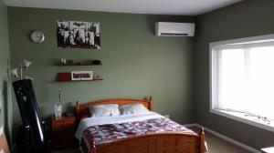 Mitsubishi Hyper Heating ductless system installed in a bedroom in Barrington, IL.
