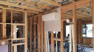 Mitsubishi MSZ-FH06 wall mount indoor unit installed as part of a multi-zone Hyper Heat H2i system in a Net Zero, LEED, solar powered new construction home project in Palatine, IL.