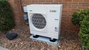 Mitsubishi PUY outdoor air conditioning unit, installed by Compass Heating and Air Conditioning, Inc.