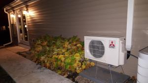 Wheaton family room addition utilizing a Mitsubishi Hyper Heat heat pump for the source of heating and air conditioning.