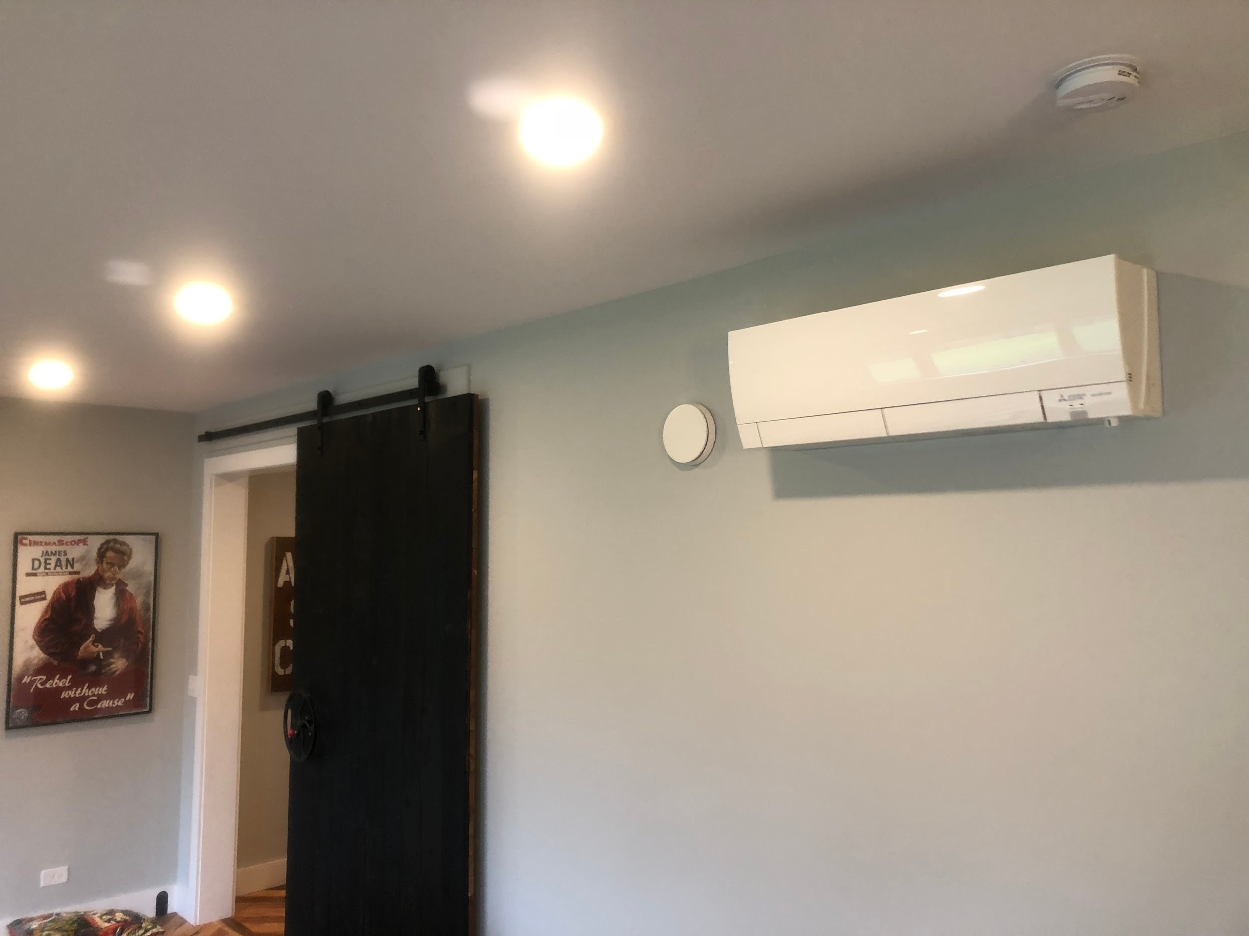 A ductless panel, or air handler, in the living room of a Palatine, IL home