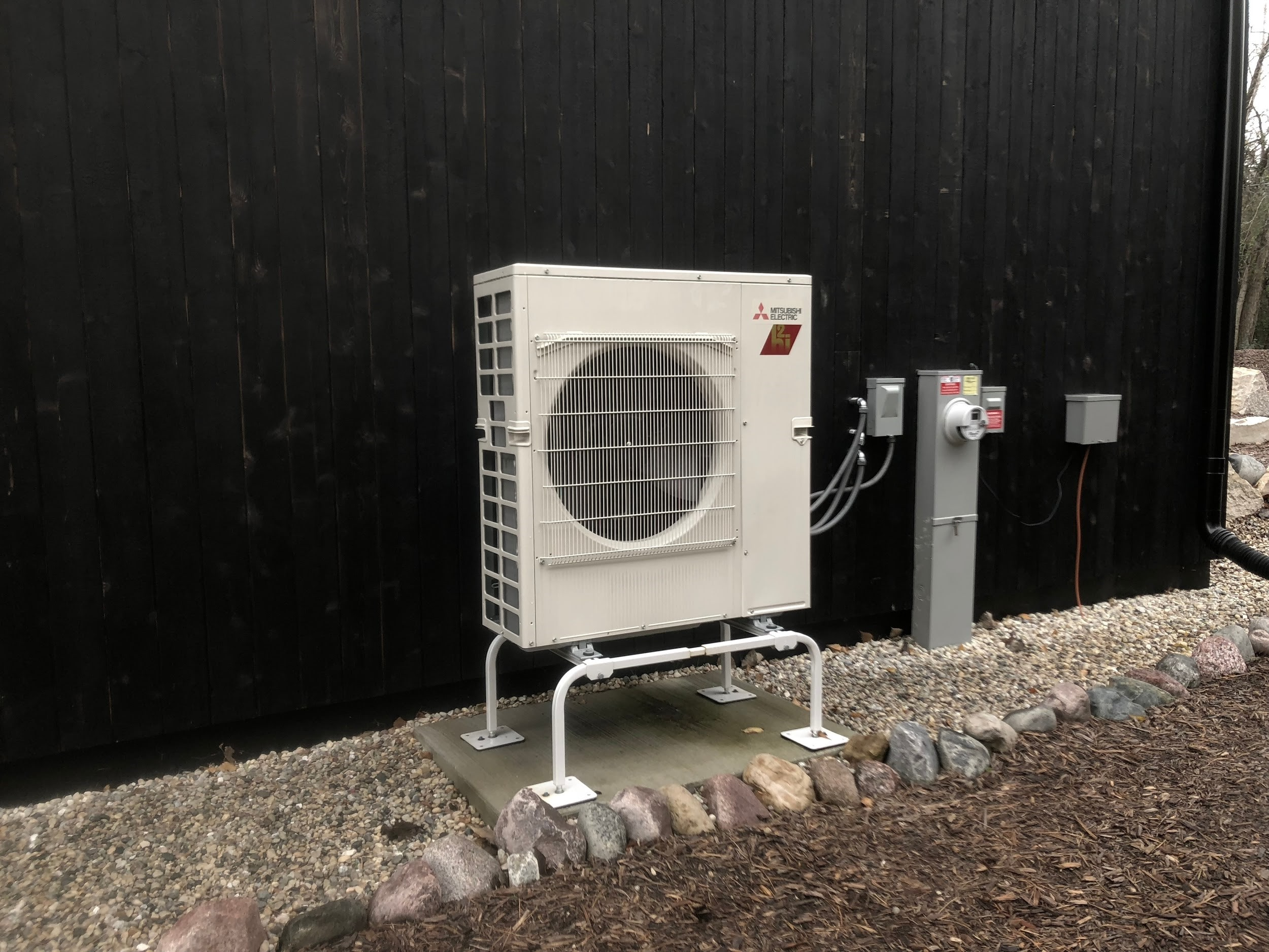 A heat pump provides energy-efficient heating and cooling in a green home