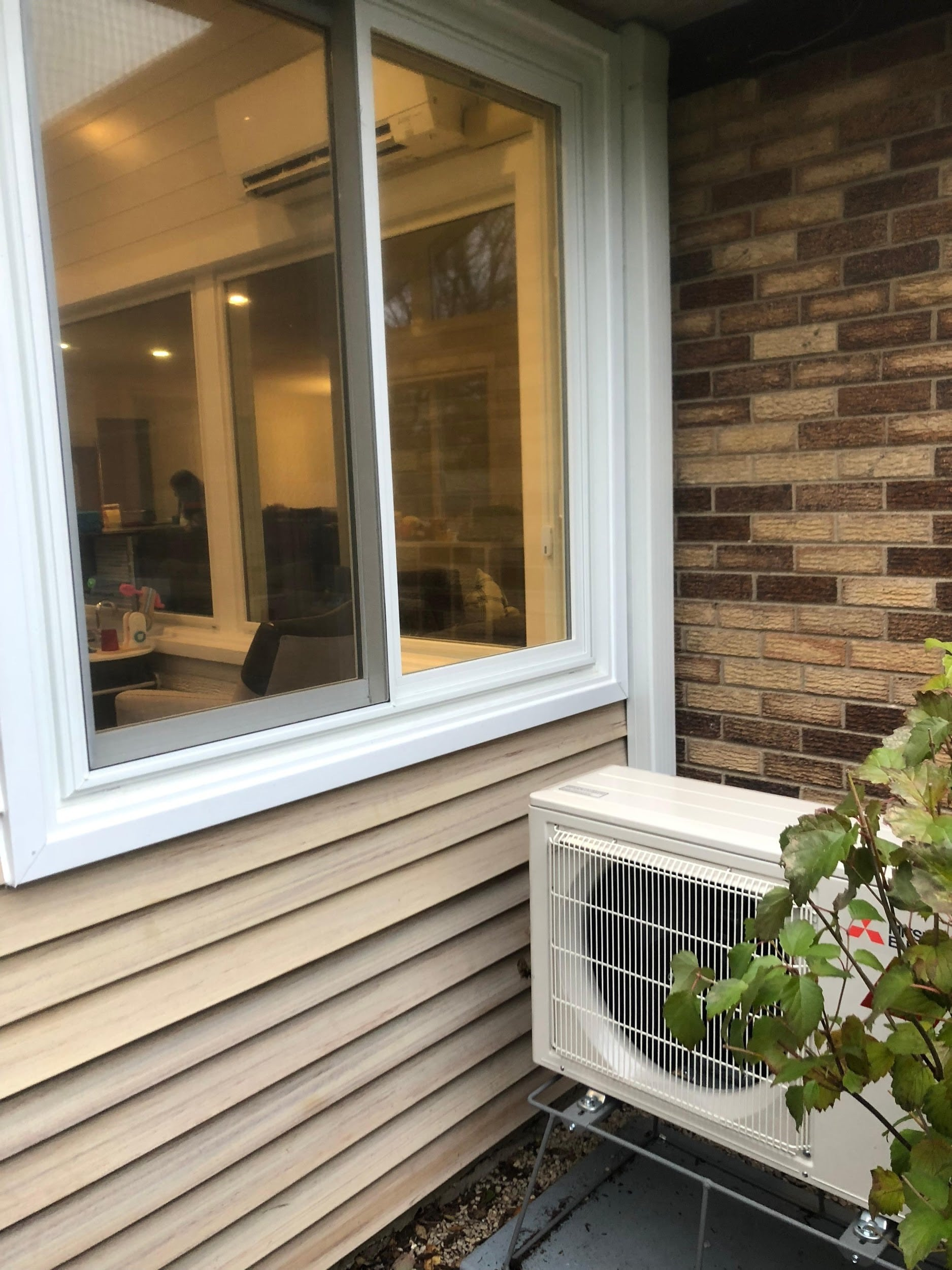 A heat pump provides heat and ac for a Wheaton, IL sunroom.