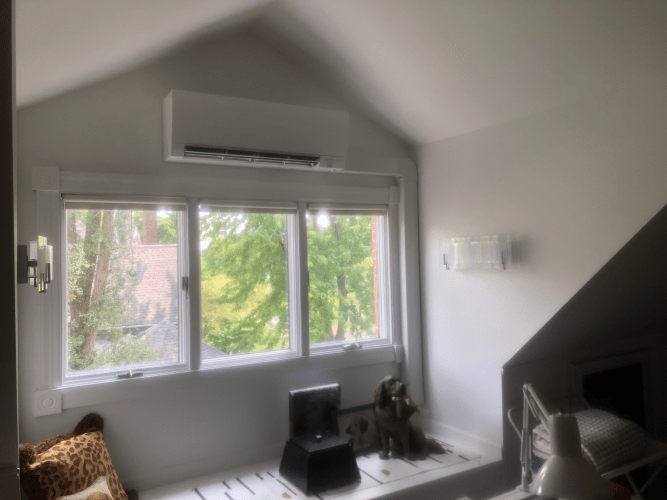 A ductless unit hangs out of the way in this Barrington home, keeping this space cozy